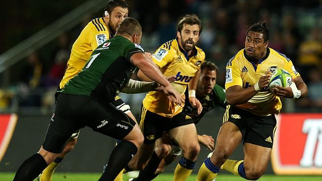 Julian Savea makes a charge for the Hurricanes.
