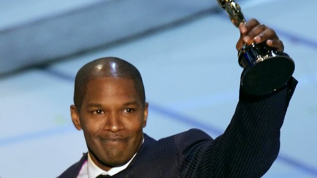 Jamie Foxx accepts his Oscar for Best Actor for his role in film Ray. Picture: AP