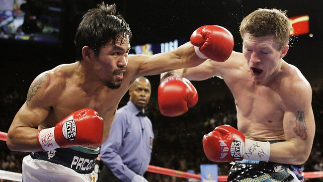 Manny Pacquiao (L) throws a left to the head ofRicky Hatton during their junior welterweight world championship title bout at MGM Grand in Las Vegas, 02/05/2009.