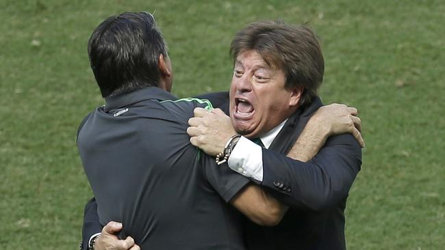 Mexico's head coach Miguel Herrera celebrates after Giovani dos Santos scored against the Dutch.