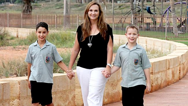 Cass Connolly with her two sons Cullen, 9, and Logan, 7, at Cemetery Beach in Port Hedland. Picture: Stacey Hambling.