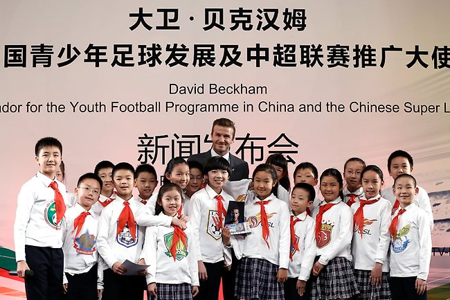 BECKS IN BEIJING. Football superstar David Beckham with students at a middle school in Beijing as part of a a five-day tour. Picture: Lintao Zhang