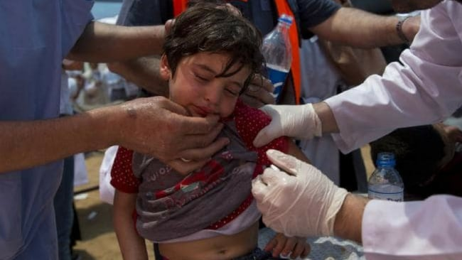 Horrifying images of children tear-gassed by Israel have emerged. Photo: AP/Dusan Vranic