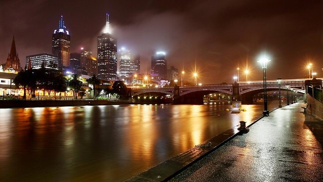 Heavy rain arrives over the city in Melbourne to mark the first day of winter. Picture: Ian Currie