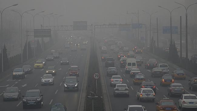 How's the serenity ... Cars travel in heavy smog in Beijing earlier this year. Picture: AP