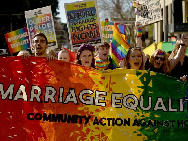 Same-sex marriage supporters rally in Sydney. Picture: AFP/Peter Parks
