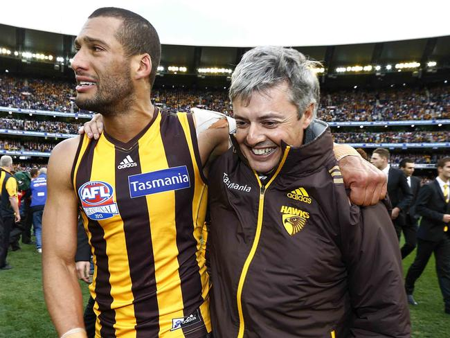 Hawks defender Josh Gibson with Newbold after 2013 AFL Grand Final. Picture: Michael Klein