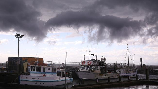 Storm clouds pass over fishing boats at Mornington Harbour. Picture: Michael Dodge/Getty Images