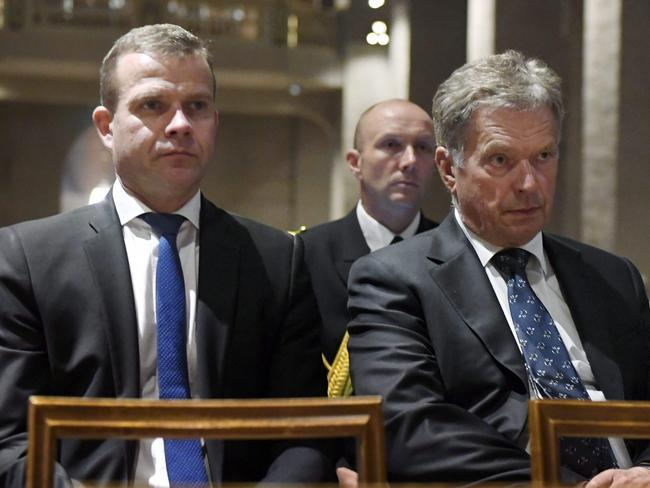President of Finland Sauli Niinisto and Finland's Minister of Finance Petteri Orpo (L) attend a prayer service at the Turku Cathedral for the victims. Picture: AFP