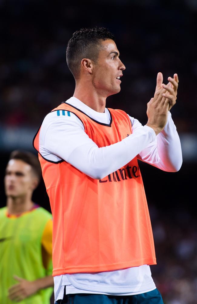 Cristiano Ronaldo celebrates Gerard Pique's own goal.