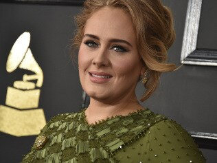 Adele at the 59th annual Grammy Awards. Photo by Jordan Strauss/Invision/AP, File)
