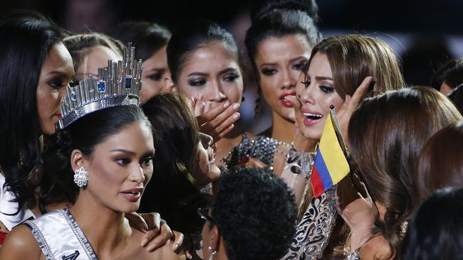 Other contestants comfort Miss Colombia Ariadna Gutierrez, top right, after she was incorrectly crowned Miss Universe. Picture: John Locher/AP Photo