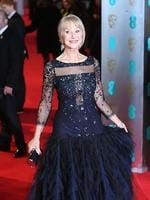 Dame Helen Mirren poses for photographers on the red carpet at the EE British Academy Film Awards held at the Royal Opera House on Sunday Feb. 16, 2014, in London. Picture: AP