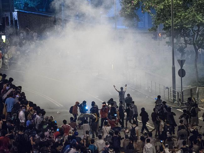 Police fire tear gas into a crowd of demonstrators. Pic: Getty.