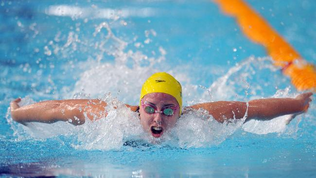 Emma McKeon of Australia competes in the 100m butterfly heat.