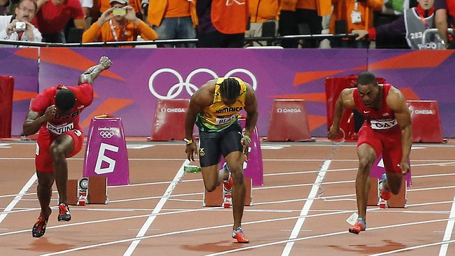 The plastic bottle lands behind Jamaican sprinter Yohan Blake at the start of the men's 100m final. Picture: Supplied/EPA