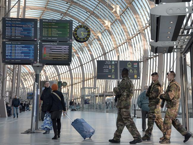 French soldiers patrol Strasbourg railway station in France after the terror attacks in Brussels. Picture: AFP/Patrick Hertzog