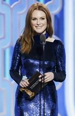 Presenter Julianne Moore speaks onstage during the 73rd Annual Golden Globe Awards at The Beverly Hilton Hotel on January 10, 2016 in Beverly Hills, California. (Photo by Paul Drinkwater/NBCUniversal via Getty Images)