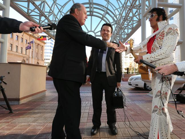 Defence Minister David Johnston with Senator Nick Xenophon and an Elvis impersonator. Picture: Tait Schmaal.