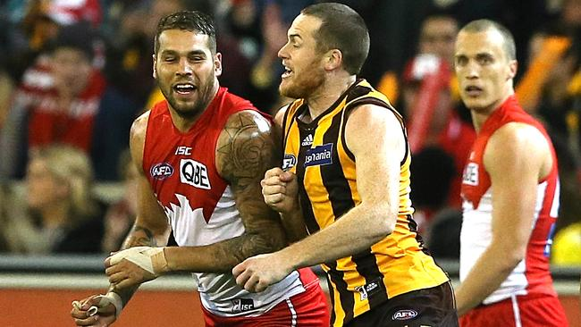 Lance Franklin and Jarryd Roughead get re-acquainted. Picture: Wayne Ludbey