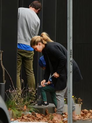 Belle Gibson and partner Clive Rothwell and son Olivier outside their house in Elwood.Picture:Rob Leeson