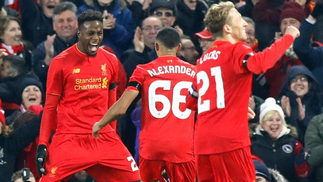 Liverpool's Divock Origi, left, celebrates scoring his side's first goal against Leeds.