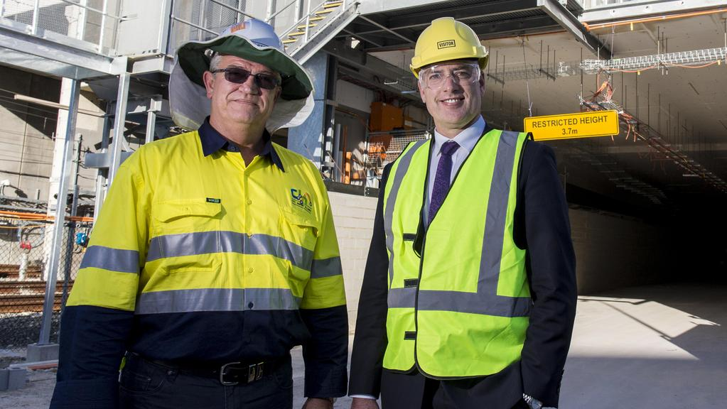 Project co-ordination manager for City Bus Port Alliance David Callcott with Minister Dean Nalder in Perth. Picture: Matthew Poon