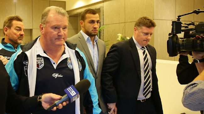 Blues winger Blake Ferguson is escorted from the Crowne Plaza at Coogee yesterday en route to Waverley Police Station. Picture: Bob Barker