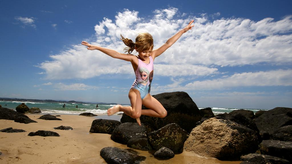 7yr old Nelly Witell from Sweden enjoys her first swim in Australia at Coolangatta Beach, her dad will be a visiting Professor at University of Queensland for a month. Photo: David Clark