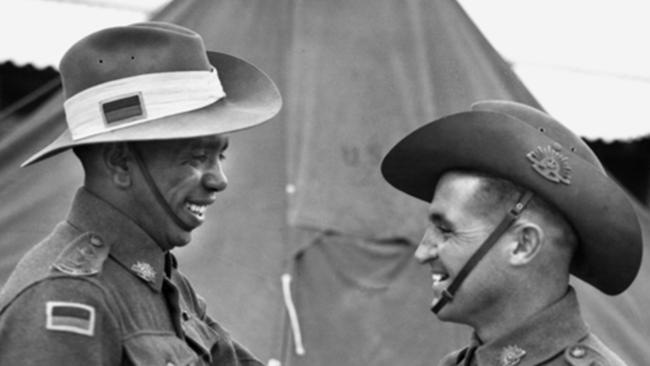 Lieutenant R.W. Saunders VC DCM (left) and Lt T.C. Derrick (right) shaking hands as they congratulate each other following their successful graduation from the Officer's Cadet Training Unit at Seymour. Lt Saunders was the first Aboriginal commissioned in the Australian Army. Picture: Australian War Memorial