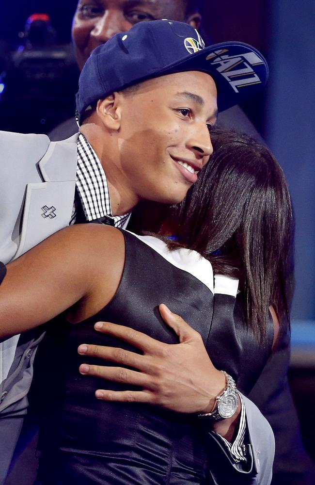 Dante Exum, left, hugs friends and family after being selected by the Utah Jazz.