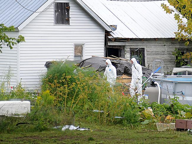 Examination ... investigators search the Hermon, New York, home of Stephen Howells II and Nicole F. Vaisey. Picture: AP/Watertown Daily Times