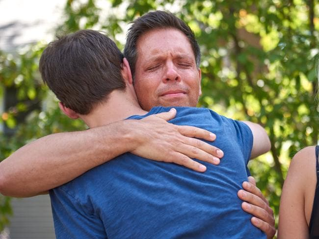 Justine Damond's fiance Don Damond hugs a neighbour after speaking to the media in Minneapolis.