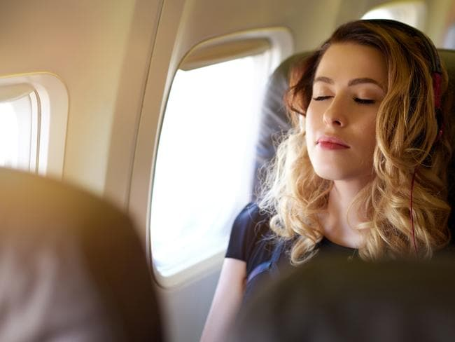 portrait of young woman with her eyes closed enjoying a good and relaxing flight.photo taken in the airplane. Picture: iStock  Escape travel wisdom