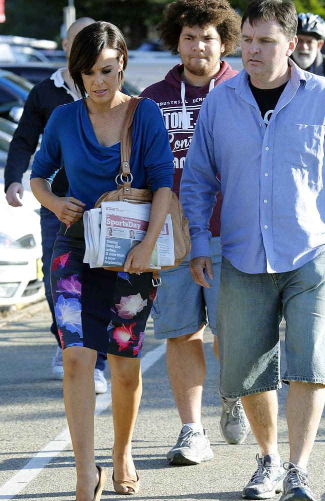 Channel Ten' Wake Up presenter Natarsha Belling appeared upset as she left the show's Manly studios as other staff hugged and supported each other after reports the show is to be canned