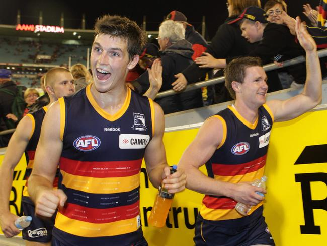 Phil Davis and Patrick Dangerfield celebrate a win when they Crows teammates.