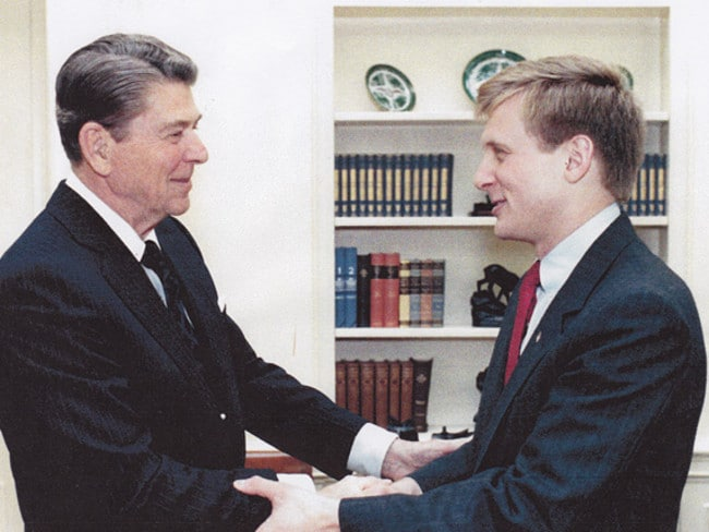 Todd Blodgett (right) with former US President Ronald Reagan in the 80s before he was recruited by the FBI to spy on white supremacist groups.