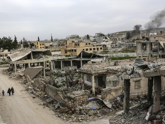 A neighbour in ruins ... the Syrian town of Kobane, pictured on March 27, 2015. Picture: AFP Photo / Yasin Akgul