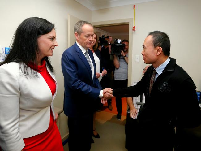 Opposition Leader Bill Shorten meets with George Asiak and Dr Kean-Seng Lim, during a visit to the Mt Druitt Medical Centre in Western Sydney. Picture: Alex Ellinghausen