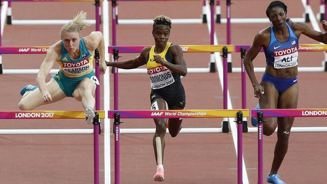 (L-R) Sally Pearson, Jamaica's Megan Simmonds and US athlete Nia Ali compete in the semi-final.