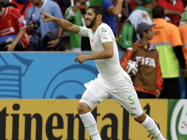 Rafik Halliche celebrates after scoring Algeria's second goal against South Korea.