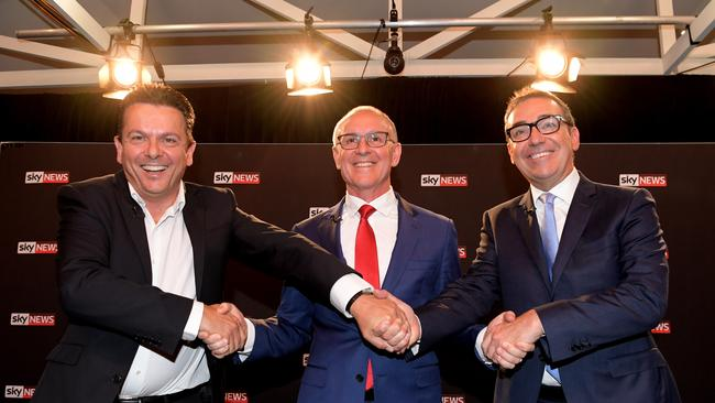 SA Best leader Nick Xenophon, Premier Jay Weatherill and Liberal leader Steven Marshall shake hands at the Sky News people's forum in Elizabeth on Wednesday night. Picture: Tracey Nearmy/AAP