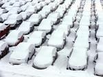AMERICA: Cars are covered by snow in rental car parking lot at O'Hare International Airport in Chicago. Picture: AP