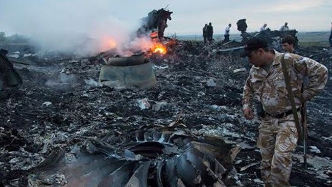 Soldiers at the MH17 site shortly after the crash.
