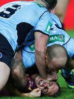 Queensland's Corey Parker cops a facial from NSW captain Paul Gallen during State of Origin III.