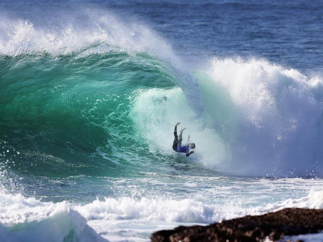 Richie 'Vas' Vaculik wipes out during the Red Bull Cape Fear surfing event at Cape Solander, Sydney. Picture: Brett Costello