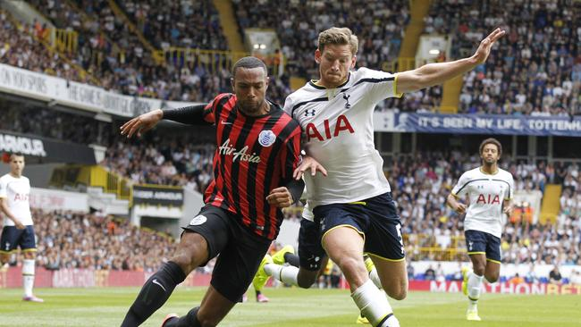Tottenham Hotspur's Jan Vertonghen, right, competes with Queens Park Rangers' Matt Phillips.