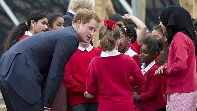 Centre of attention ... Prince Harry charmed dozens of children at the park, which was built for the 2012 London Summer Olympics. Picture: Getty