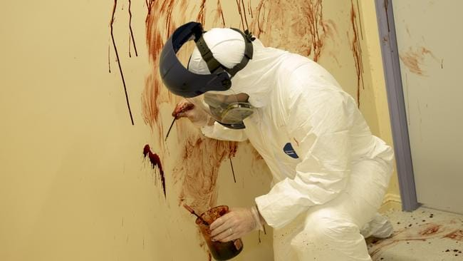 Shawn Harkins uses a pipette filled with horse blood to create the realistic crime scenes. Photo: Richard Tuffin