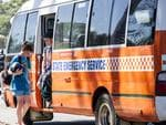 A State Emergency Service bus drops off a family from the fire zone at the Murray Leisure Centre. Picture: Matthew Poon